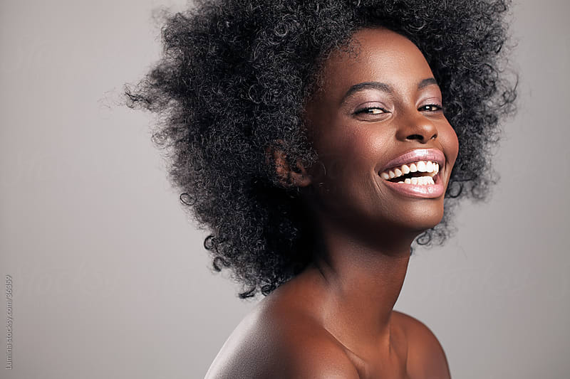 Smiling African Woman by Lumina for Stocksy United