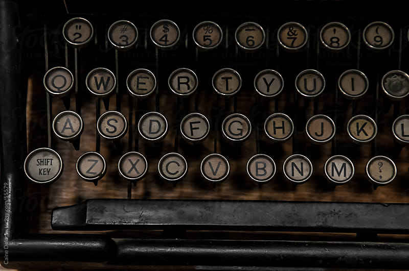Antique typewriter with round keys by Caine Delacy for Stocksy United