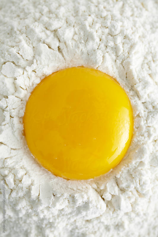 Egg yolk by Paperclip Images for Stocksy United