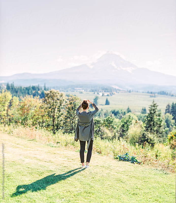 Woman viewing Mt. Hood by Daniel Kim Photography for Stocksy United