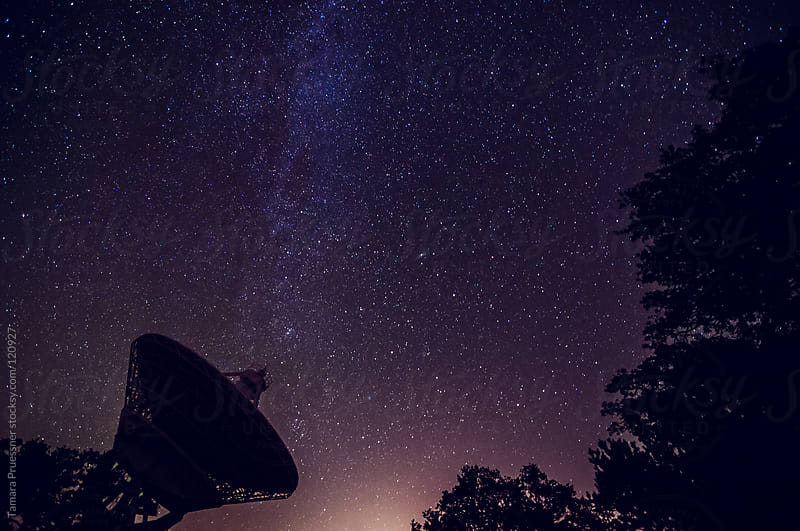 Silhouette Of Satellite Dish And Stars by Tamara Pruessner for Stocksy United