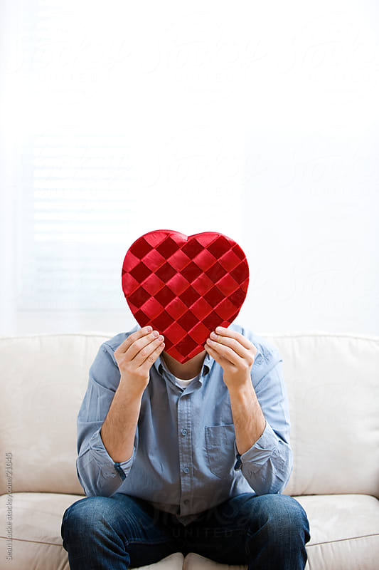 Valentine: Man Hiding Behind Box of Valentine's Candy by Sean Locke for Stocksy United
