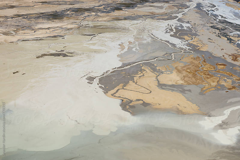 aeriel shot of an abstract looking dried out lake  by Leander Nardin for Stocksy United