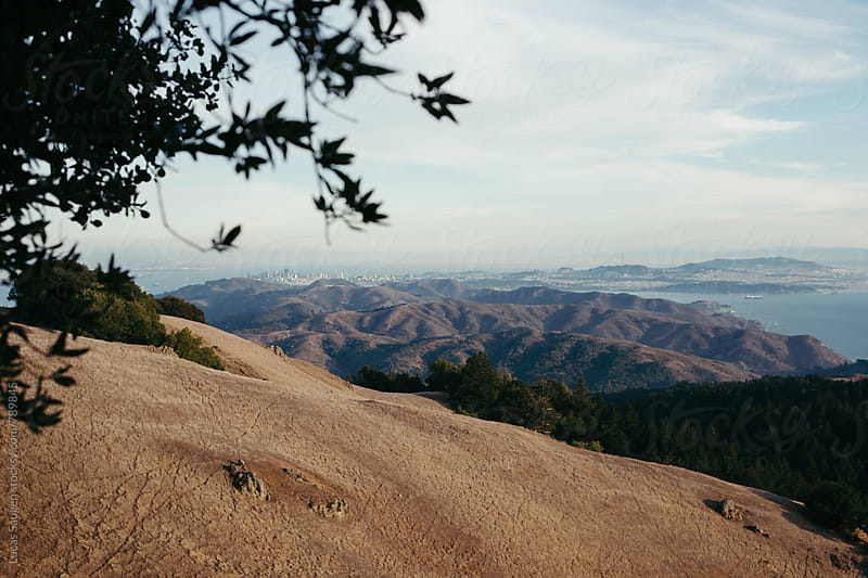 A view of the Marin Headlands and San Francisco in the distance. by Lucas Saugen for Stocksy United
