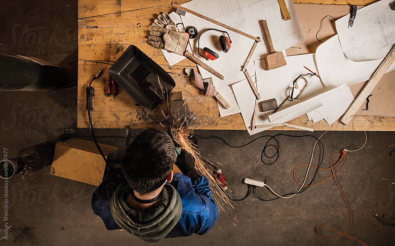 Look from above on male working in his small workshop by Audrey Shtecinjo for Stocksy United