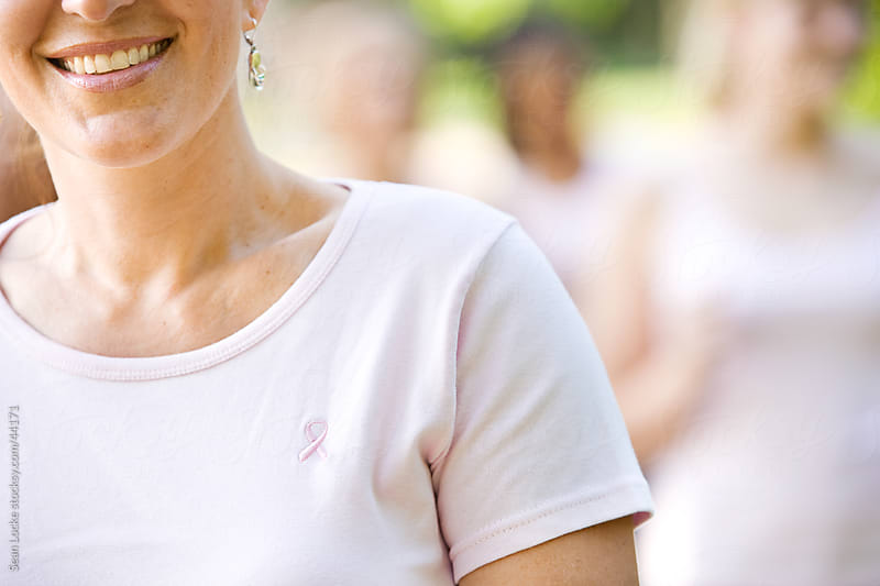 Charity Walk: Focus on Pink Ribbon on Shirt by Sean Locke for Stocksy United