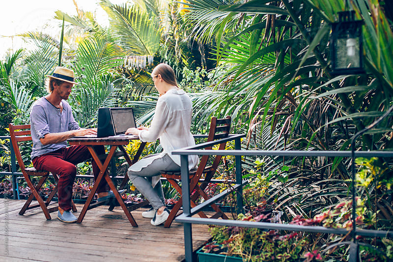 Young Couple Working in a Tropical Garden by Lumina for Stocksy United