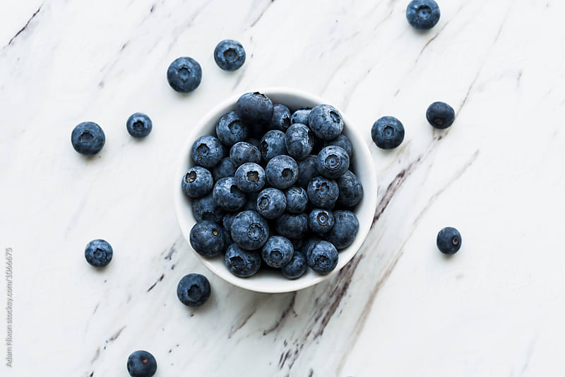 Bowl of fresh Blueberries by Adam Nixon for Stocksy United