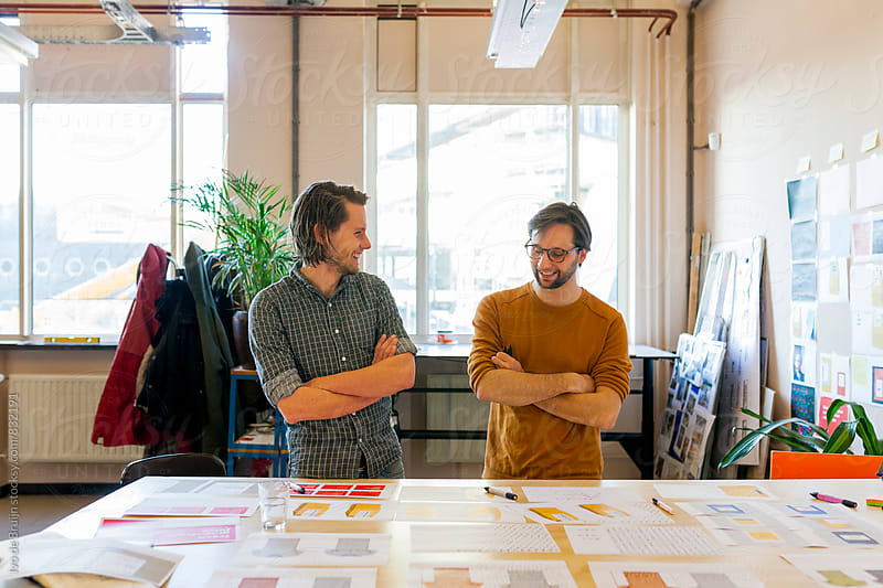 Two designers or creative professionals working in their studio or workplace by Ivo de Bruijn for Stocksy United