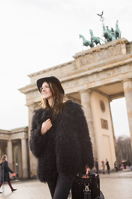 Attractive young woman in front of Brandenburg Gate by Irina Efremova for Stocksy United