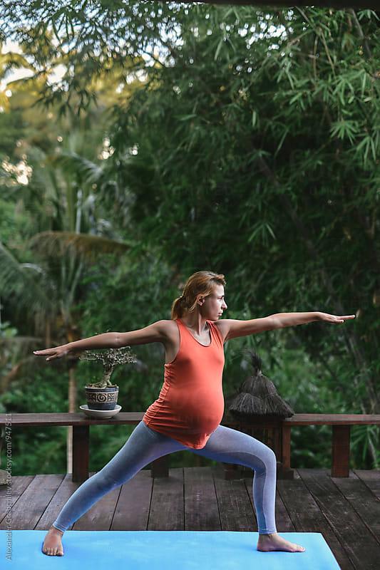 Pregnant Yoga by Alexander Grabchilev for Stocksy United