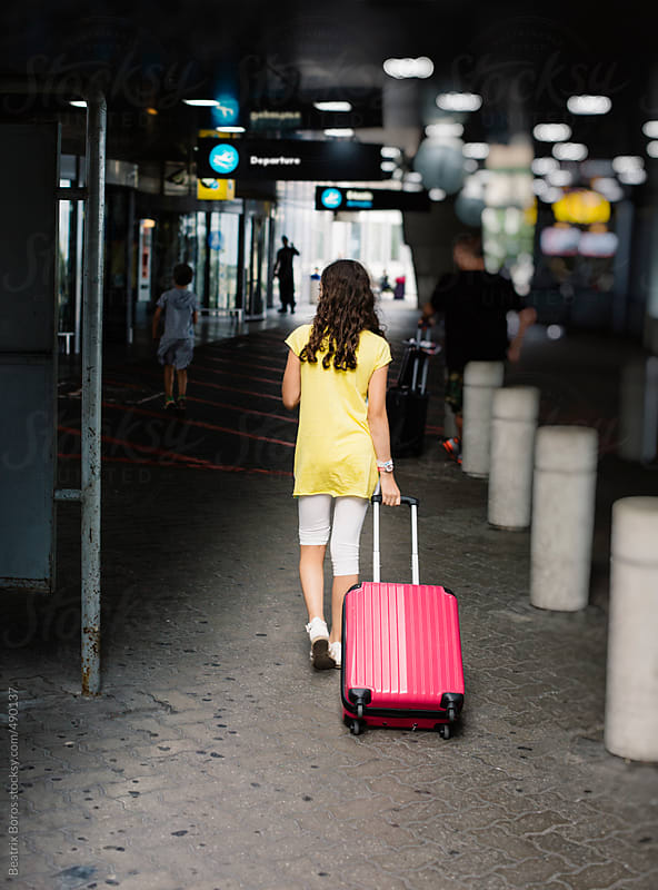 Preteenager girl has arrived at the airport, ready to depart by Beatrix Boros for Stocksy United