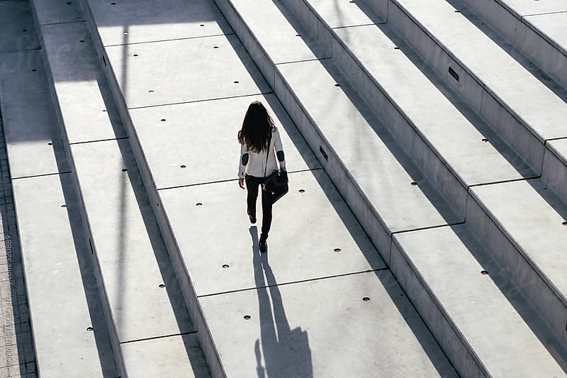 Overhead of a young businesswoman walking in the city. by BONNINSTUDIO for Stocksy United