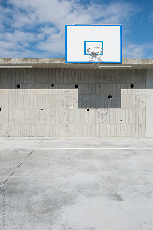 Cement wall and floor of basketball court and blue sky by Lawren Lu for Stocksy United
