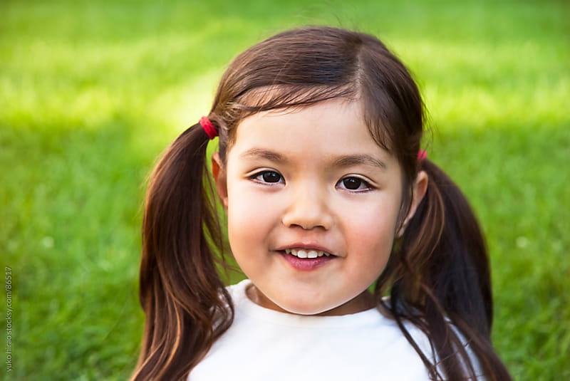 Asian Hispanic preschooler girl portrait outdoors by yuko hirao for Stocksy United