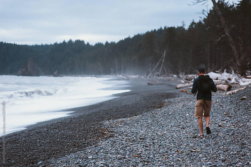Man Hiking on the Rocky Shore of the Pacific Ocean in Washington by michelle edmonds for Stocksy United