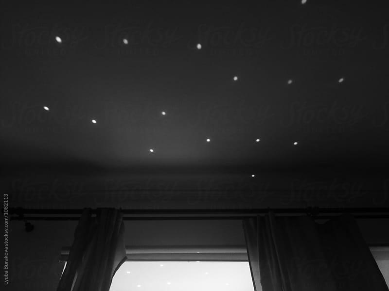 Light dots on a ceiling like stars by Lyuba Burakova for Stocksy United