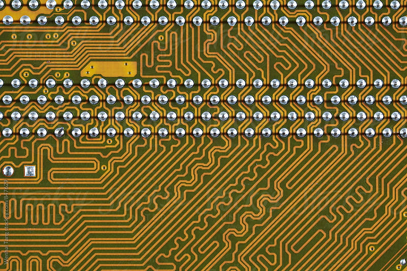 Gold circuit board background of computer motherboard by Wenhai Tang for Stocksy United