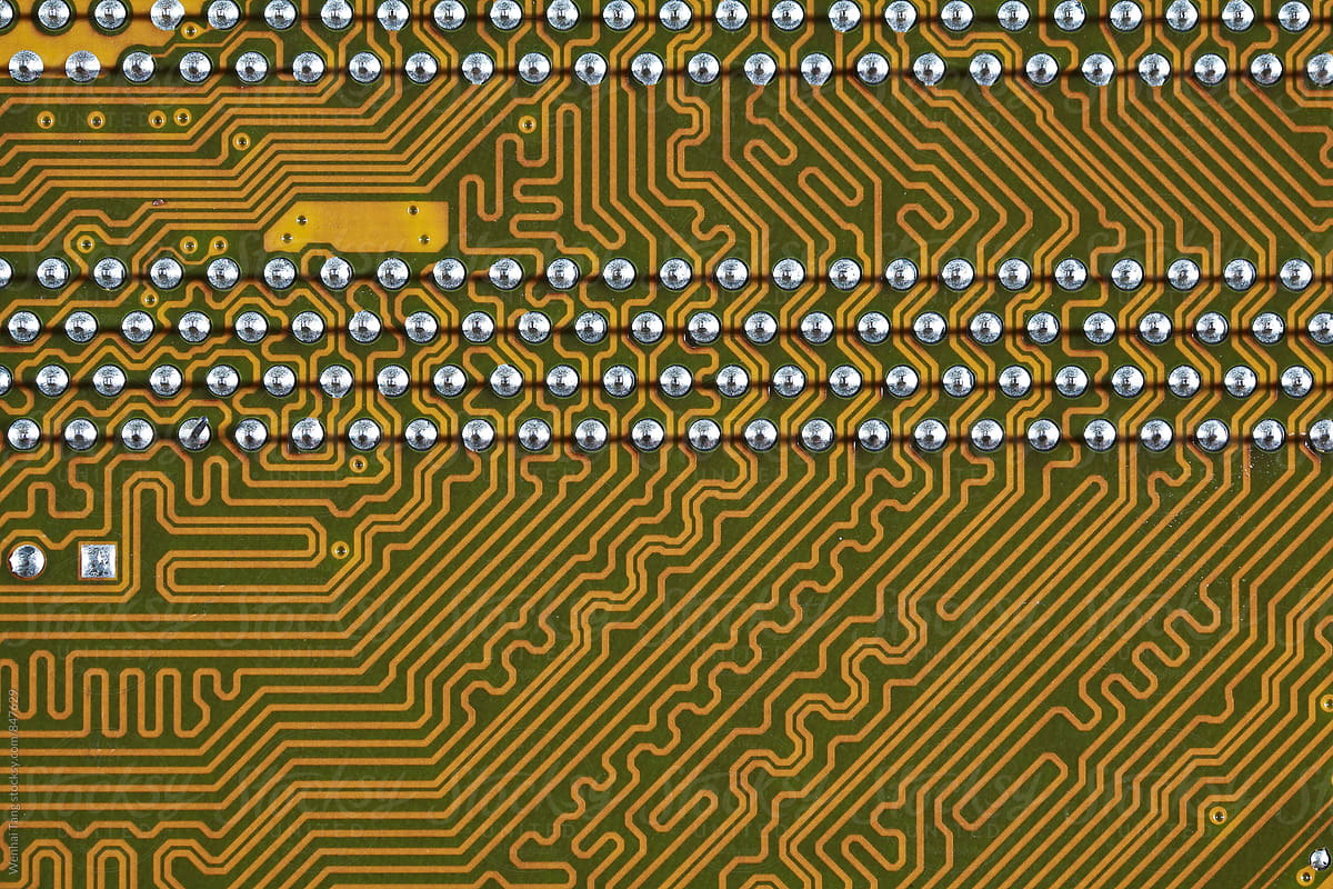gold circuit board background of computer motherboard stocksy united