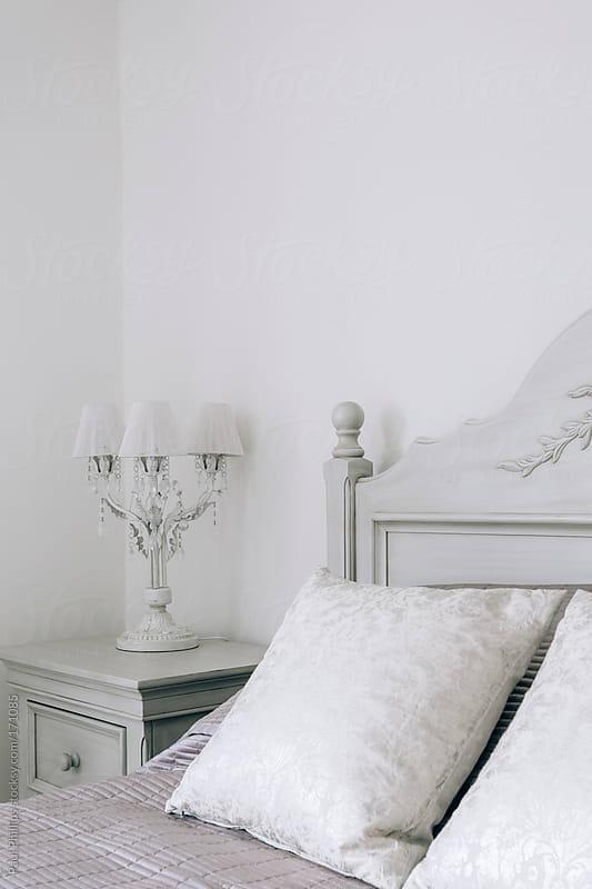 Corner of a white bedroom by Paul Phillips for Stocksy United