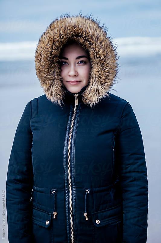 Young Woman Winter Beach Portrait by Eldad Carin for Stocksy United