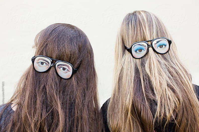 Long hair and crazy eyed glasses by Carolyn Lagattuta for Stocksy United