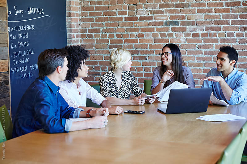 Group of millennials in meeting at start up business by Trinette Reed for Stocksy United