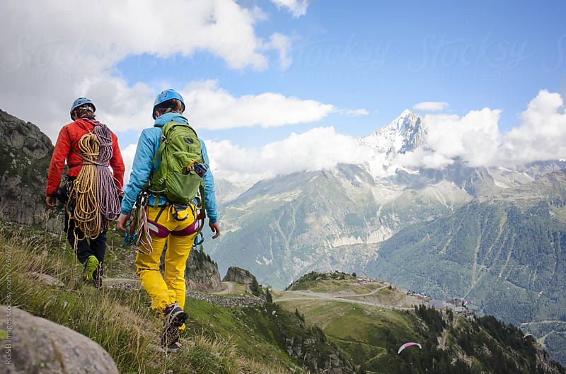 Mountain climbers walking down a path in the French Alps by RG&B Images for Stocksy United