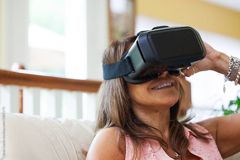 VR: Woman Enjoying Fun Of Virtual Reality Headset by Sean Locke for Stocksy United