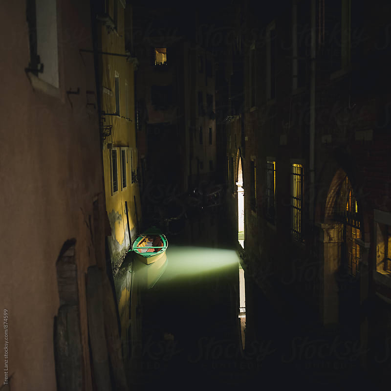 Venice boat in Canal at night under light by Trent Lanz for Stocksy United