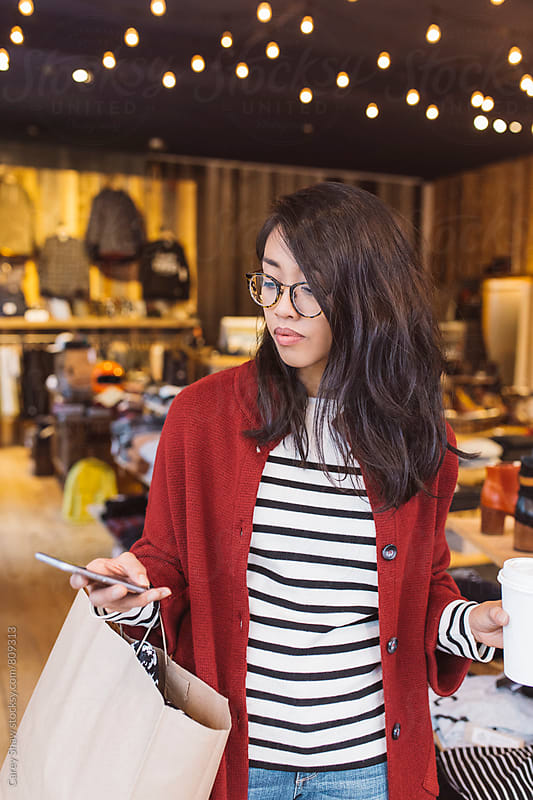 Stylish woman shopping in local urban store by Carey Shaw for Stocksy United