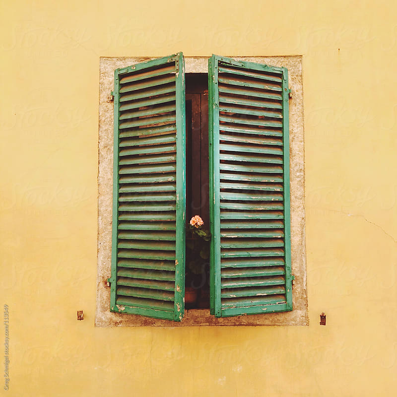Window shutters in Italy by Greg Schmigel for Stocksy United