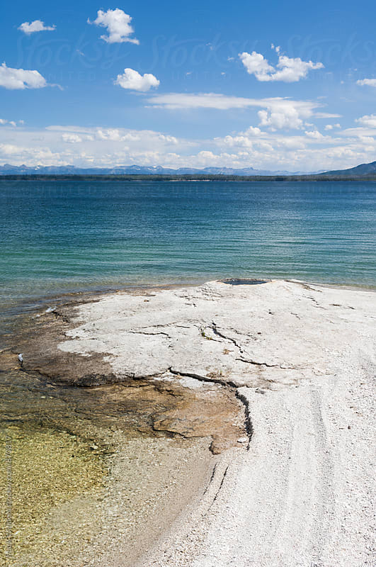 Geyser and lake, Yellowstone by Mark Windom for Stocksy United