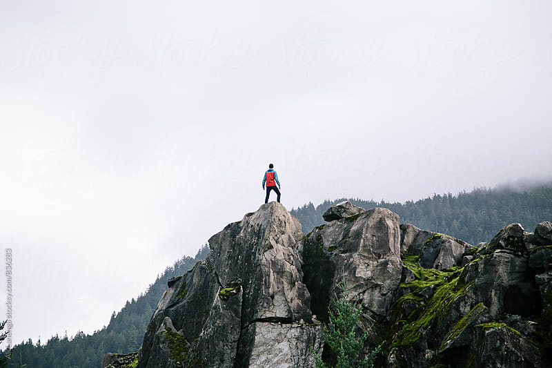 Man on the summit by Ali Lanenga for Stocksy United