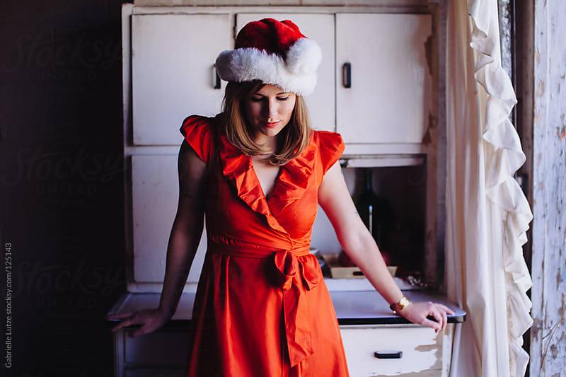 Pretty Girl in Santa Hat by Gabrielle Lutze for Stocksy United