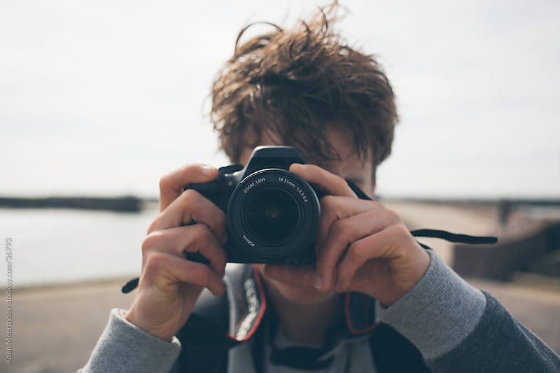 Young guy taking a photo with his camera by Koen Meershoek for Stocksy United