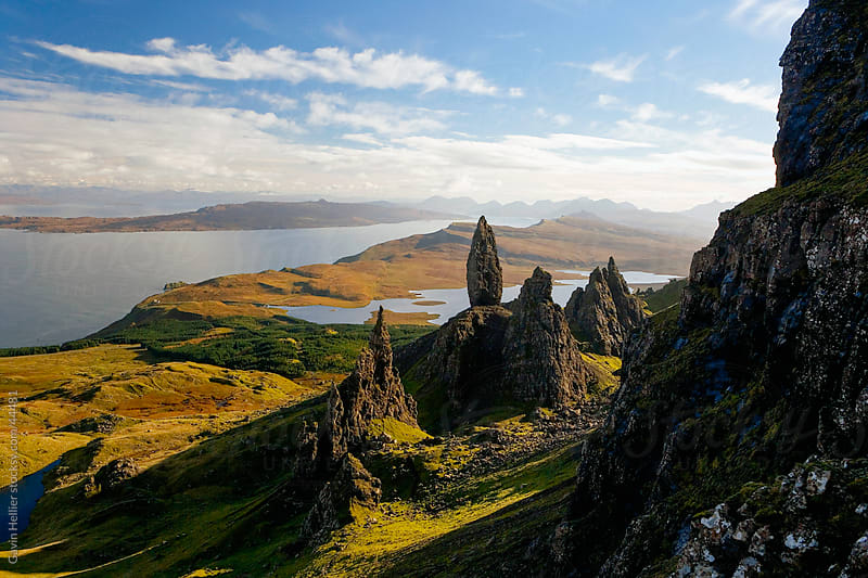 The Old Man of Storr, overlooking Loch Leathan and Raasay Sound, Isle of Skye, Inner Hebrides, Highland region, Scotland, United Kingdom, Europe by Gavin Hellier for Stocksy United