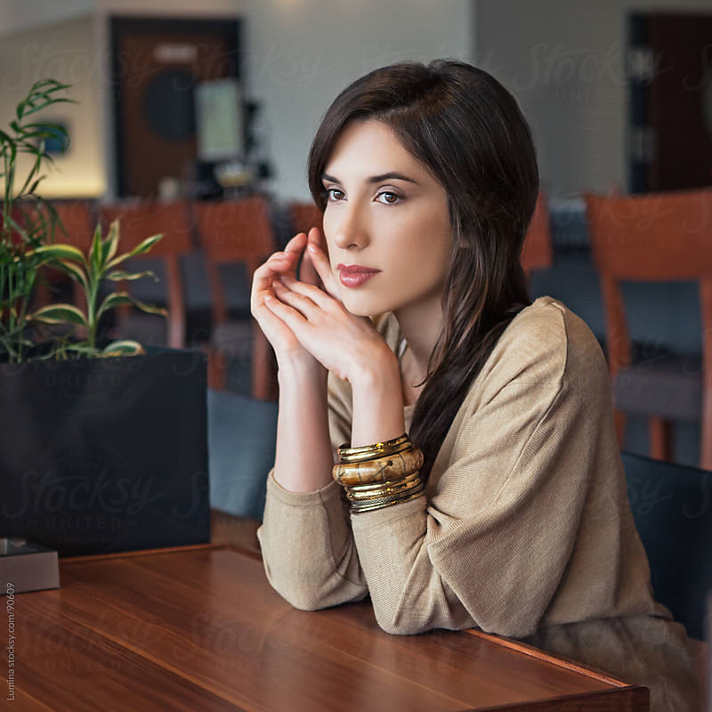 Woman Alone at a Cafe by Lumina for Stocksy United