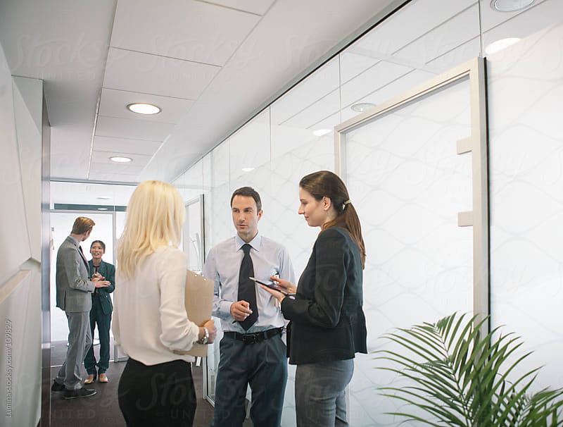 Business People in the Hallway by Lumina for Stocksy United