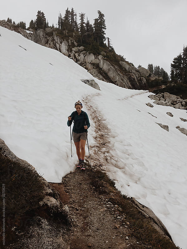 Female Hiker on a Snowy Mountain Trail in Washington by michelle edmonds for Stocksy United