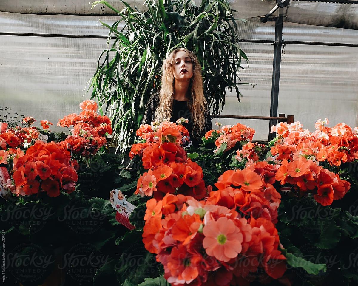 A Portrait Of A Beautiful Woman In A Orangery Stocksy United