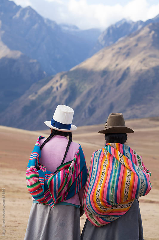 Traditional Peruvian women in the mountains near Cusco. by Hugh Sitton for Stocksy United