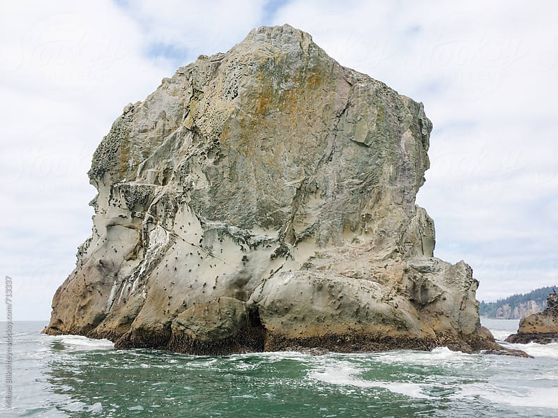 Closeup of a rock cliff in the ocean along Washington coast by Mihael Blikshteyn for Stocksy United