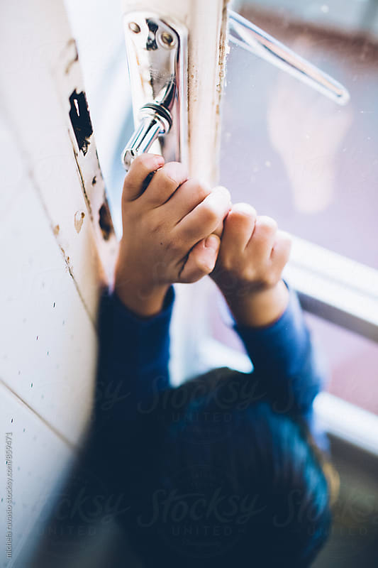A child opening the door by michela ravasio for Stocksy United