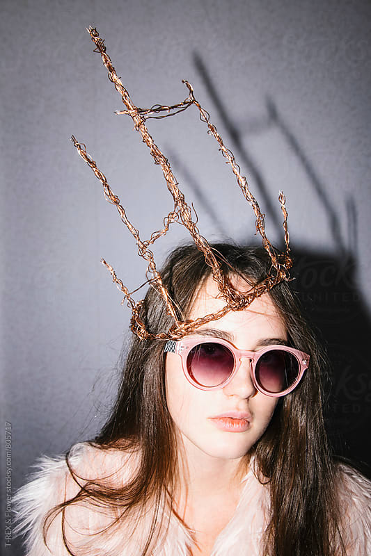 Woman wearing handmade crown and sunglasses by Danil Nevsky for Stocksy United