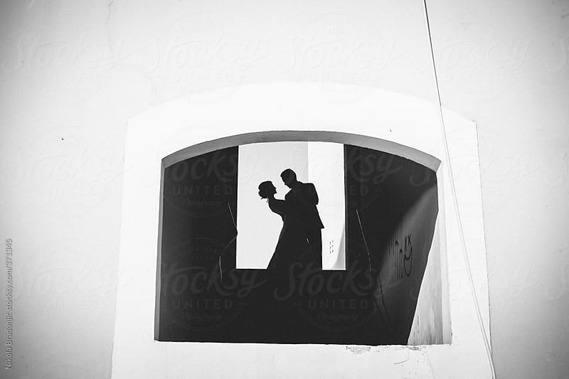 Silhouette of couple in romantic dance by Nikola Bradonjic for Stocksy United