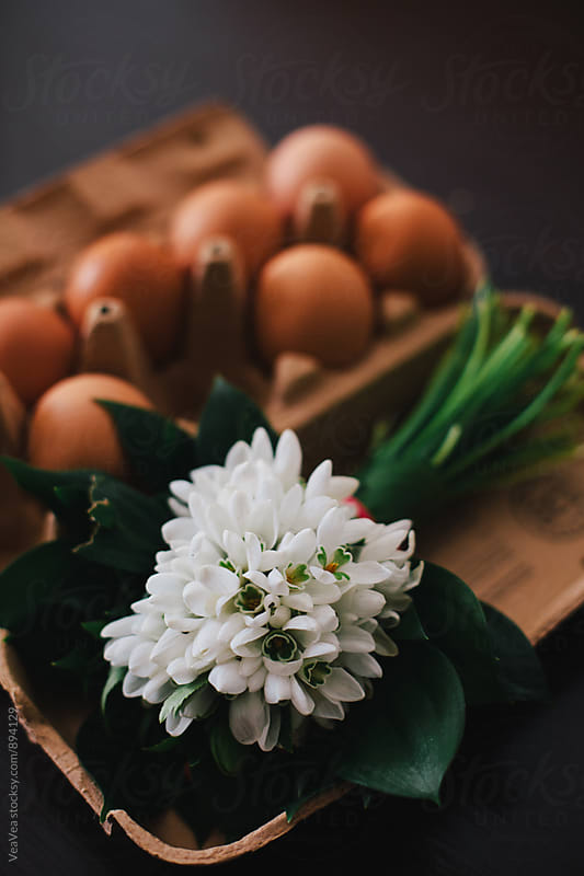 Bouquet of snowdrops and eggs on a table  by Marija Mandic for Stocksy United