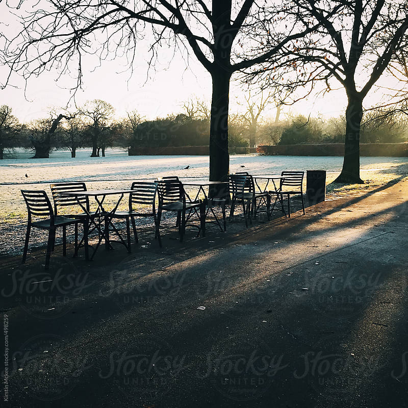 Chairs in a park on a frosty morning in London by Kirstin Mckee for Stocksy United
