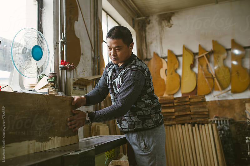 Violin maker at work by Maa Hoo for Stocksy United