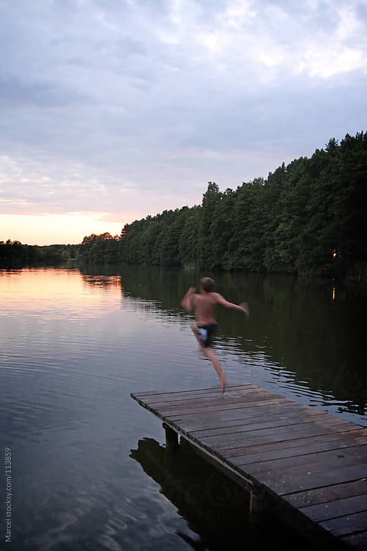 Jump in the lake at sunset by Marcel for Stocksy United